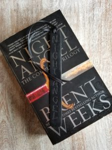 black bookmark with black ribbon and the words Night Angel etched into it