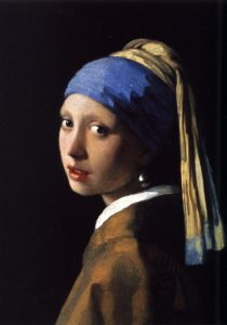 classic Vermeer portrait of a young woman wearing a blue headscarf