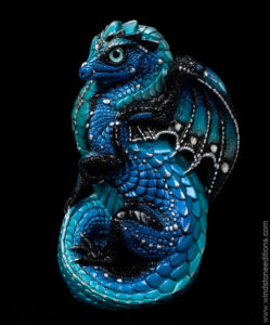 Small sculpture of a young blue dragon