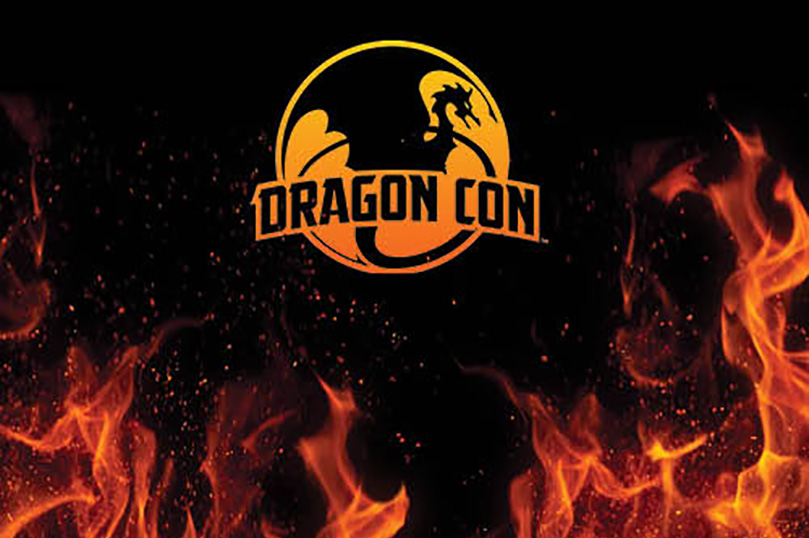 DragonCon logo with black background and red/orange flames